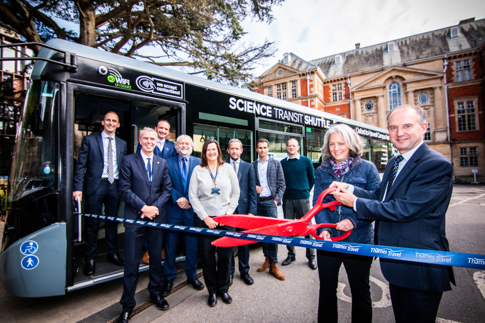 Photo of ribbon-cutting ceremony at the entrance to the Science Area, to mark the launch of the new Science Transit Shuttle.