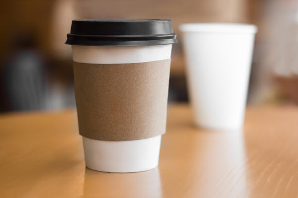 Photo of disposable coffee cups on a table.