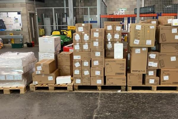 Photo of boxes of PPE in the Old Road Campus Distribution Centre