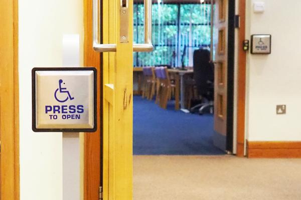Photo of disabled access push button