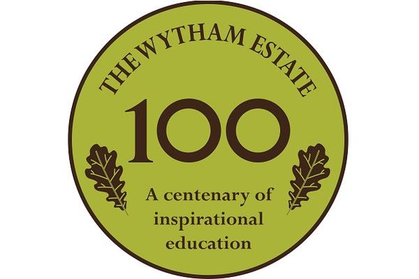 Round, green logo with '100' in the centre and the words 'The Wytham Estate, A centenary of inspirational education'