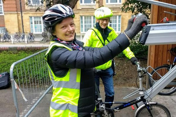 Harriet Waters, Head of Environmental Sustainability, tests the bike racks