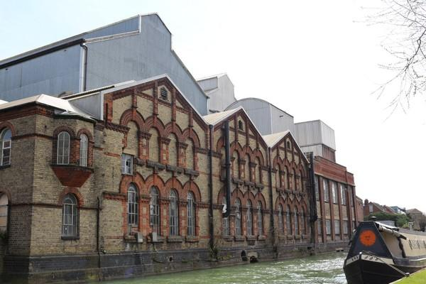 Landscape photo of the old Osney Power Station alongside a canal