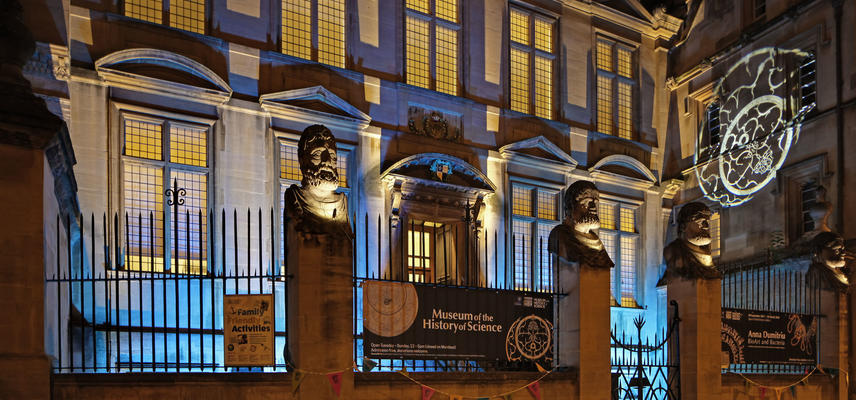 Photo of the exterior of the History of Science Museum lit up at night