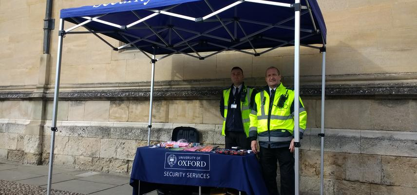 Photo of Security Services staff on the pop-up stand in Radcliffe Square, promoting cycle safety and security.