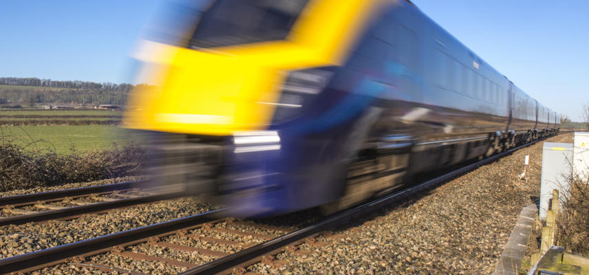Photo of modern train passing at speed.