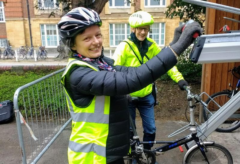 Harriet Waters, Head of Environmental Sustainability, tests the bike racks