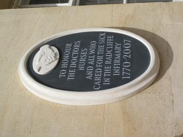 Photo of plaque reading 'To honour the doctors, nurses and all who cared for the sick in the Radcliffe Infirmary 1770-2007', white text on black background