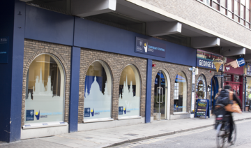 Photo of the exterior of the Temporary Staff Service building, with a blue front and the Oxford skyline traced on the arch-shaped windows